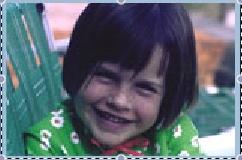 Monica grins